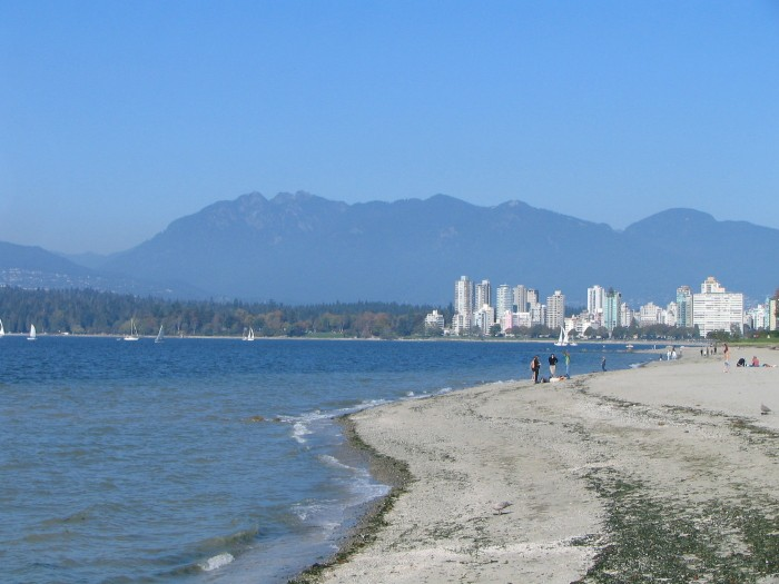 Kitsilano_Beach_with_the_West_End,_Stanley_Park_and_the_North_Shore_Mountains_in_the_distance